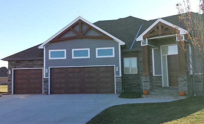Fake Is The New Fabulous - Just Check Our Our Faux Wood Garage Doors